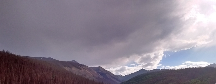 Large storm clouds over mountains in Colorado.