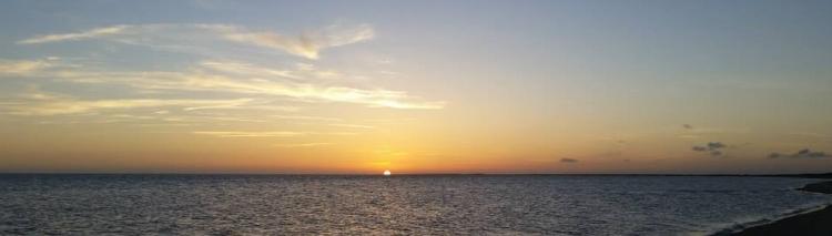 Sunset over an ocean beach